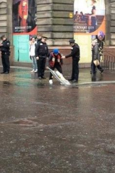 Just someone hoovering a puddle... In Glasgow......
