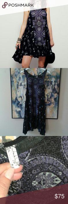 Free People Slip Dress Sz L, EUC. Medallion Print. Black, purple and mint. Has keyhe back detail. Great layering piece. Price firm. Free People Dresses Mini