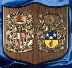 DBL Knight Shield  The Perfect Wedding Gift! Celebrate the joining of two families. Displaying the Coat of Arms for both sides of a family is a centuries old tradition which often symbolized special alliances. The authentic Coats of Arms listed under the family names are hand painted on a shield.