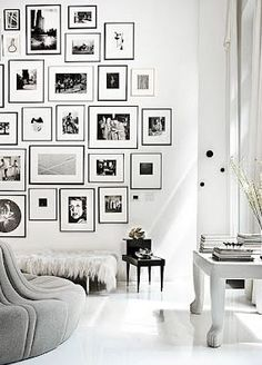 b&w photo print wall - will have one in my house. I'm turning my basement (or at least half the utility room) into a dark room.