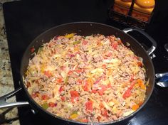 ... meat back into pan mix and simmer. Top with shredded cheese and a