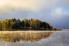 https://flic.kr/p/zDdRLd | October morning *Explored* | The mornings in october is really something special with the mist dancing like elves on the lake. Combined with the autumn colors that now are peaking here in Sweden it makes for something special I think.  Explored 20151018   Thank you for all views faves and comments!