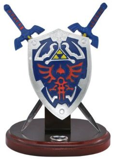 """ZELDA swords & shield letter opener set by Grey Eagle. $28.47. From The Game The Legend of Zelda Hylian Shield Twilight Princess Sword & Shield Letter open Display Desk set Approx. 7"""" Overall Wood Base w/Metal Hardware Stainless Steel Blades"""