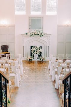 Thicket Priory - the Best wedding venue in Yorkshire and North East England. This is the Morning Room which is a light filled wedding ceremony room with a large marble fireplace, wooden flooring and wooden panels and large windows. Perfect venue for light and airy fairytale spring weddings. Styled by Flori and Fern and captured by destination wedding photographer Cristina Ilao