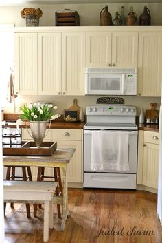 cream cabinets and wood countertops