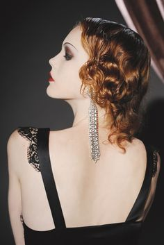 Myla London's silk polyamide and lace gown. Barbara Flood's Closet earrings.