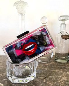 SHOP STEFANIE PHAN CLUTCH BAGS. Handmade couture acrylic clutches with hand painted graffiti bag design.