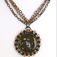 Mysterious Black and Copper Pendant | AllFreeJewelryMaking.com