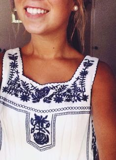 2017 Spring & Summer Fashion trends! Beautiful white sleeveless shirt with navy embroidering at neckline and bib. Nice clean look. Navy & white - boho - stitch fix wish list. #sponsored #affiliate