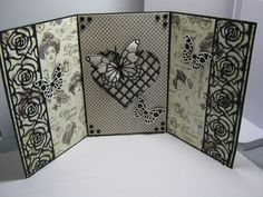 This is a card made by Sharon Frees.  I used Gina Marie Designs rose die, MB Butterflies dies, & Spellbinders lattice die.  I used Graphic 45 paper.  There is a 2nd view.
