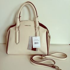 """London Fog satchel with strap extension! Chic and sleek, just so sophisticated.  Color blocked for contrast and style.  Very good size, with removable and adjustable strap extension.  Front is 12"""" wide and about 10"""" at its tallest.  Bottom of bag is 12"""" by 4.5"""".  NWT! London Fog Bags Satchels"""