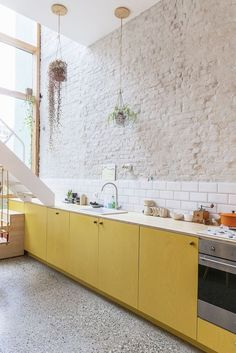 Kitchen Color Trends mellow yellow kitchen color trend with white brick wall and subway tile backsplash Kitchen Inspirations, Scandinavian Kitchen, Kitchen Interior, Kitchen, Yellow Kitchen, Kitchen Trends, Kitchen Color Trends, Kitchen Remodel, Stylish Kitchen