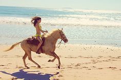 Horseback riding on the beach is fun, perhaps not in a bikini though.