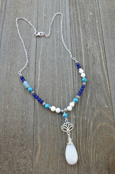 Blue stone, white stone. Wire wrapped pendant, silver metal and stone necklace.
