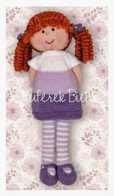 Słodka lala z lokami wykonana z włóczki akrylowej.   Włosy są zrobione na szydełku i przyszyte do głowy.   Ubranka - sukienkę i sweterek ...