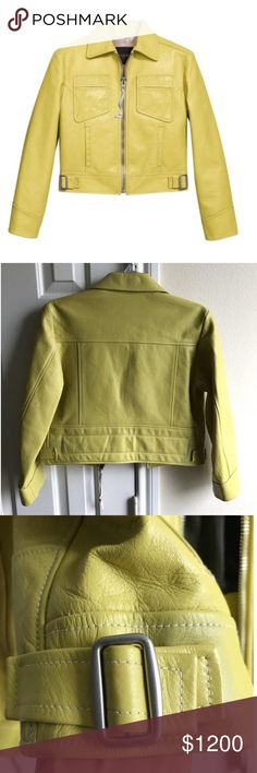 """Coach NEW cropped leather moto jacket slime green jacket was originally $1595! It is BRAND NEW WITH TAGS!!! Please see pics!! I WILL take offers!!! There is a TINY TINY pen mark on arm that is not noticeable unless you look for it. It is not even 1/10th the size of my nail. 😍 I am looking at any and all offers. Lowball offers such as $50, will be ignored. If sending offer please be fair ! size 2. Cropped. Yellowish green. Color is called """"slime green"""". Pairs nicely with many other colors as…"""