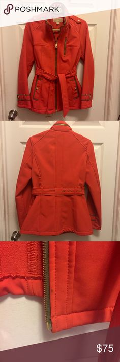 Orange Fleece Lined Michael Kors Jacket Stylish jacket in great condition! Has a hood in the zipped collar and warm fleece lining. Minor spot on bottom near zipper as shown and a few similar spots inside on the bottom, otherwise in excellent condition! Michael Kors Jackets & Coats