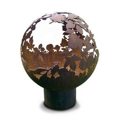 Another idea for metal man. Garden sculpture, fire pit and BBQ grill. Made in UK. Fire Pit Ball, Fire Pit Sphere, James Martin Home Comforts, Fire Pit And Bbq Grill, Iron Fire Pit, Cool Fire Pits, Stainless Steel Bbq, Rustic Feel, Leaf Design