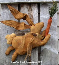 Think Spring Leaping Bunny.Folk art by Meadow Fork Primitives
