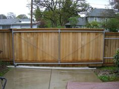 Pictures of Wood Fences by Pacific Fence and Wire in Portland, Oregon. Trust the leader in wood fence installation and call us today for an estimate! Wood Fence Gates, Fence Gate Design, Fences, Sliding Door Design, Sliding Gate, Portland House, Portland Oregon, Wood Fence Installation, Modern Wood Fence