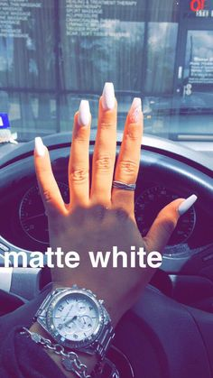 Matte white coffin nails with lace design on accent finger.