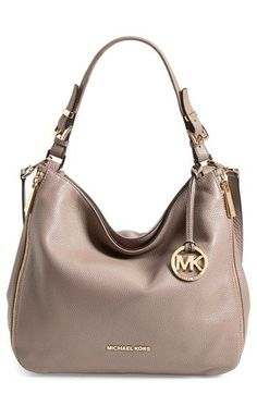 Free shipping and returns on MICHAEL Michael Kors 'Essex' Hobo at Nordstrom.com. A dangling logo medallion lends signature gleam to a buttery-soft, pebbled-leather shoulder bag, while vertical exposed-zip pockets provide a hint of contemporary edge. Sac Michael Kors, Cheap Michael Kors, Michael Kors Bedford, Michael Kors Outlet, Handbags Michael Kors, Michael Kors Shoulder Bag, Nordstrom, Mk Bags, Hobo Handbags