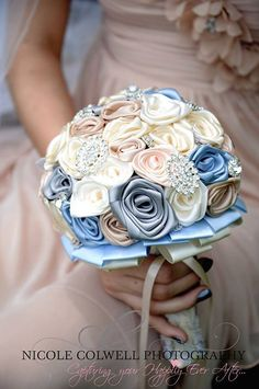 Gorgeous wedding bouquet made with satin fabric flowers and brooches.