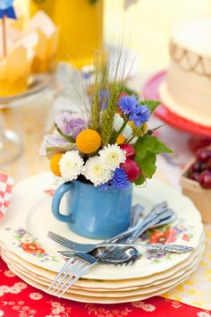make each person at your table a small bouquet in a creamer or tea cup....how adorable......or mason jar flower arrangements