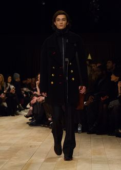 The Pea Coat in black double splittable wool cashmere, teamed with The Satchel and The Sneakers