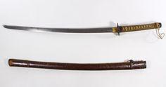 Lot 473: World War II Japanese Late War Army Officer Katana Sword; Leather combat mount over wood scabbard, blade measures 25.5 inches, menuki crude, late war with sharkskin wrap, old iron tsuba