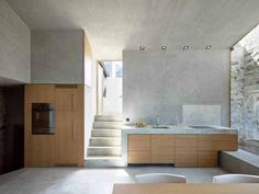 continuous concrete step into kitchen counter  ~ via wdmra.ch House PL. in Scaiano, Switzerland by Wespi de Meuron Romeo Architects. (Photography: Hannes Henz) umbau haus pl. in scaiano ti 2014