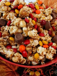 Harvest Caramel Corn - a fun Fall treat. Sweet and salty popcorn covered in delicious caramel - so delicious and so easy to make.