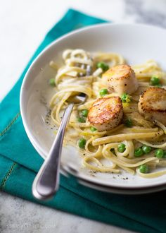 This creamy, yet light, pasta is the perfect combination of linguine, cream, parmesan and perfectly seared scallops.