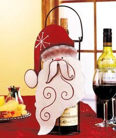 "Santa Holiday Christmas Metal Wine Caddy Tote with Carrying Handle Decoration 12-1/4"" X 7-1/4"" X 4-1/2"" by Christmas Delights. $22.99. Metal caddy holds a standard-sized bottle of wine and has a 4"" drop handle for easy carrying. Santa, 12-1/4"" x 7-1/4"" x 4-1/2"".. Sturdy Metal. A festive Holiday Wine Caddy is perfect for presenting a bottle of wine at the table or giving it as a gift. Makes a bottle of wine part of your holiday decor. A festive Holiday Wine Caddy is perfect ..."