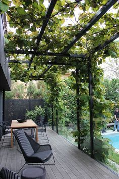 The wooden pergola is a good solution to add beauty to your garden. If you are not ready to spend thousands of dollars for building a cozy pergola then you may devise new strategies of trying out something different so that you can re Steel Pergola, Pergola Patio, Pergola Plans, Black Pergola, Modern Pergola, Timber Pergola, Black Deck, Wisteria Pergola, Corner Pergola