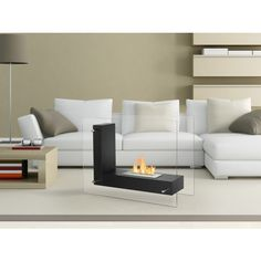 Whether you install it in the den, living room, or bedroom, you'll find yourself enchanted by the welcoming warmth of this Vitrum L White Freestanding Ventless Ethanol Fireplace. White Fireplace, Modern Fireplace, Fireplace Design, Fireplace Mantels, Small Fireplace, Bioethanol Fireplace, Freestanding Fireplace, Thing 1, Contemporary Decor