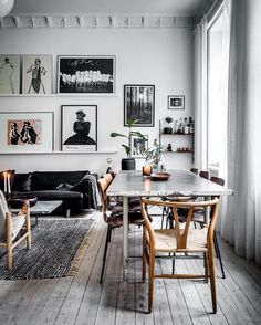 What a lovely space!We just love the black and white decor of this dining room, and really love the wall gallery in the back. Just a well designed home!