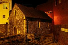 St Edmund's Chapel at Night, 14 Priory Road, Dover CT17 0QX, Kent, England, UK. Consecrated 1253 by St Richard of Chicester, dedicated to St Edmund of Abingdon. Dissolved 1544 under Tudor King Henry VIII. Dimensions: 28 feet by 14, walls 2 feet thick. Ex-Royal Navy victualling store, store room, blacksmith's forge, Toc H. Restored 1967-1968, Saturday morning Eucharists held every week. Grade II Listed Building. Church, History, Travel and Tourism. More at http://www.panoramio.com/photo/46606493