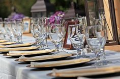 elegant, yet simple table setting for an outdoor wedding reception