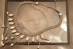 pearls on baby photo