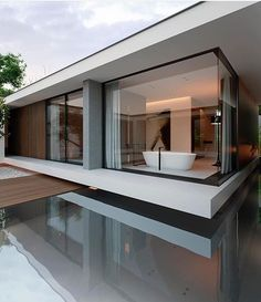 Modern house. Flat roof. Floor to ceiling Windows