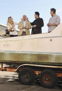 Josh Hopkins, Busy Philipps, Ian Gomez and Brian Van Holt in Cougar Town.