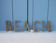 Sand Letters - could be cute for house name/shower sign for outdoor shower - somewhere small and discreet but cute