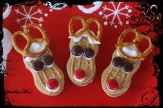 Cute and different Christmas cookie idea :) Nutter Butter Cookies Red and Brown M&Ms White frosting Small pretzels