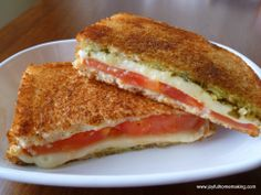 Yummy! Grilled cheese with a twist... Tomatoes, Mozerrella and pesto. Delicious!