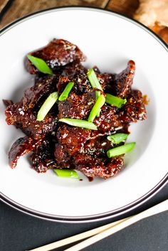 Mongolian Beef - Thin strips of beef cooked until crispy and coated in a sweet glaze.