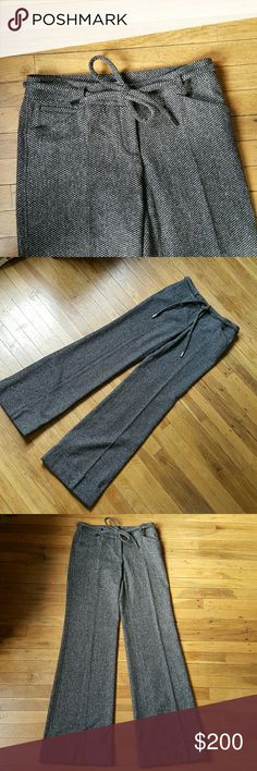 """Dolce & Gabbana tweed trousers pants cuffed Dolce and Gabbana wool blend pants. Removable tie belt. Two front pockets.  Faux back pockets. Measurement inseam 34.5, rise 8"""", waist 15.25"""" , hips 18.5- 20. These have a little bit of stretch,  but not much. The most narrow part of the leg opening measures 9.25 across front, flares out to 11.25"""" across bottom of cuff. Unlined. Very good condition. Original price is estimated. Dolce & Gabbana Pants Trousers"""