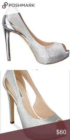 "Guess silver glitter pump Synthetic Heel measures approximately 2 inches"" glossy heel cup and stiletto heel. Heel Height: 4 1 2 in Synthetic lining and insole Platform Height: 1 in Lightly cushioned footbed for comfort                        🌺In great condition 🌺 Guess Shoes Heels"