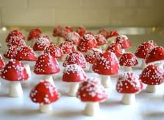 For Annabel: 50 assorted Edible Sugar Ferns & Fiddle Heads and 50 Red Chocolate Filled Toadstools Red Chocolate, Chocolate Filling, Chocolate Covered, Martha Stewart Blog, Martha Stewart Weddings, Macarons, Filled Candy, Alice In Wonderland Wedding, Mad Hatter Tea