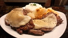 Patrons platter featuring Chuleta (Ribeye steak) topped with smoked Provolone cheese side of Jasmine rice and stewed Yuca